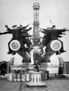 Figure 1: Sailors on the 14-inch guns of the USS Texas, the last remaining dreadnaught. (Wikipedia)